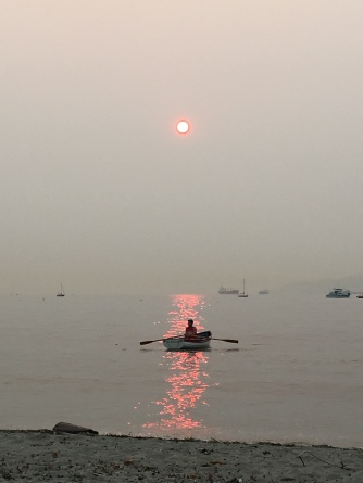 Smoky Sunset with Boat